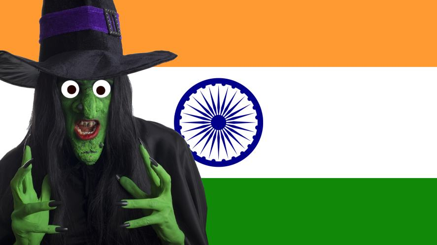 A witch standing in front of an Indian flag
