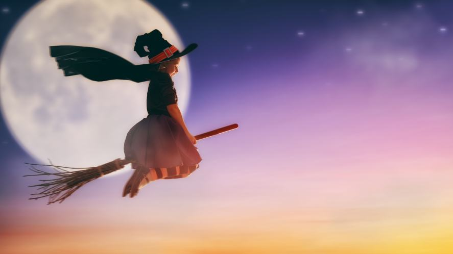 A witch flying on a broomstick