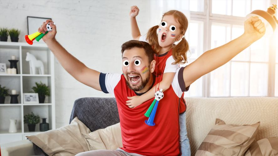 A father and daughter enjoying the big match
