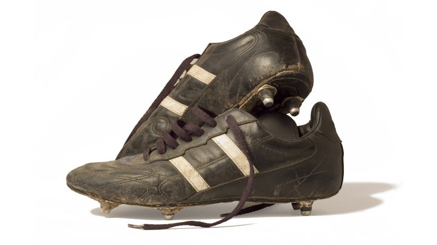 A pair of muddy football boots