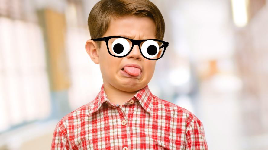 A child sticking their tongue out