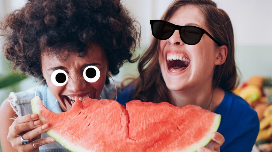 Two women laughing at fruit