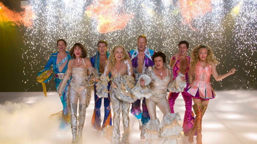 The main cast of Mamma Mia dressed in 1970s clothes