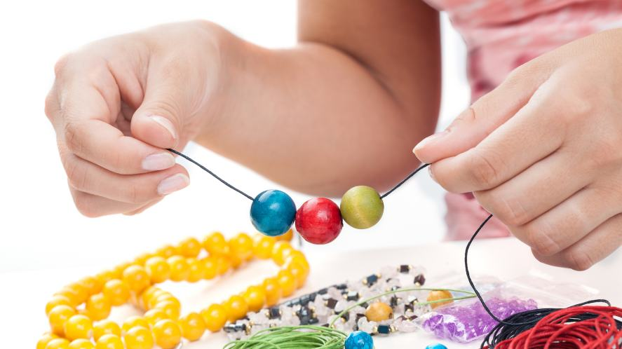 Someone making a bracelet