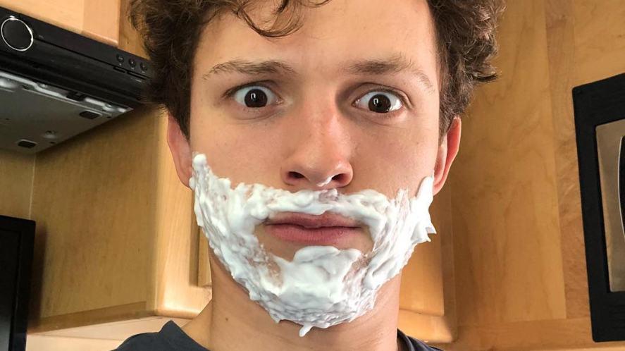 Tom Holland having a shave