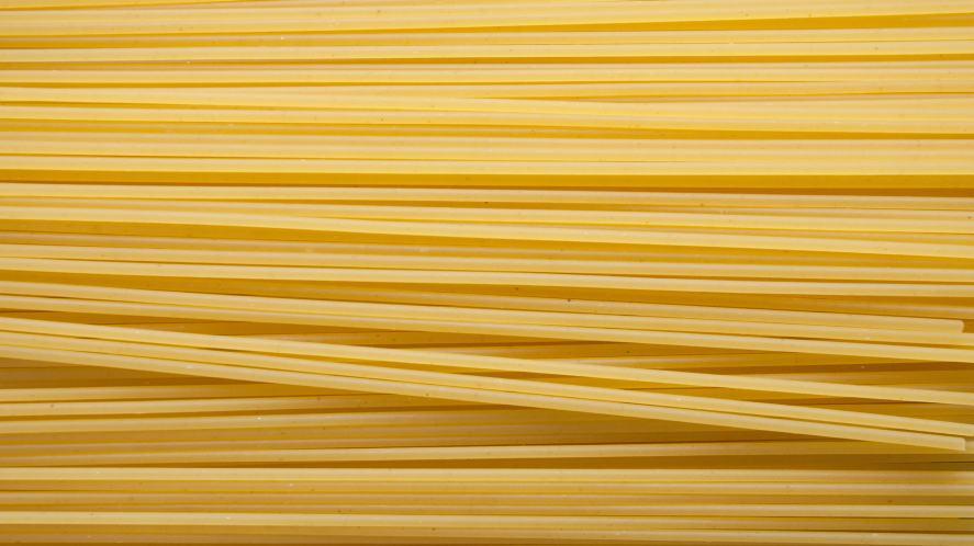 Strands of uncooked spaghetti