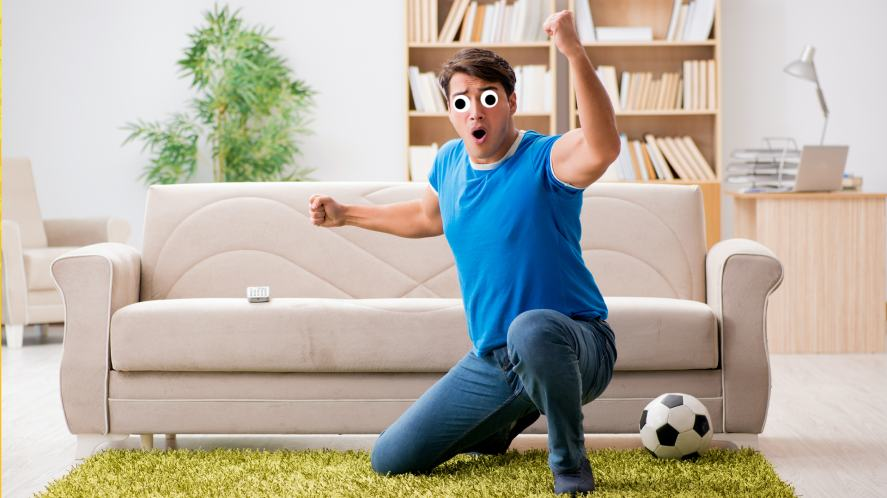 A football fan watching the match at home
