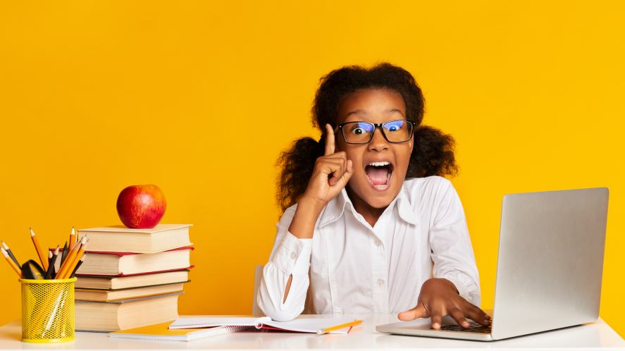 A girl doing her homework with a lot of enthusiasm