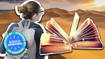 Girl, adventure book and desert
