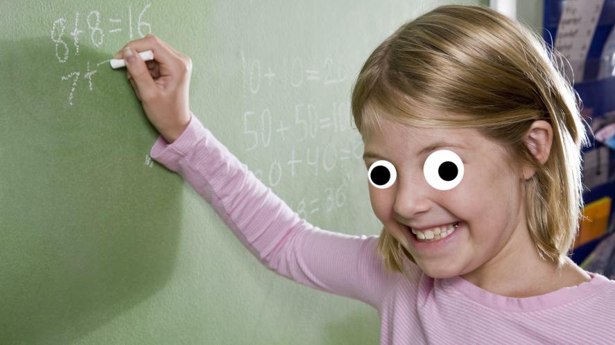 A girl writing on a chalkboard