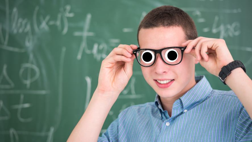 A young student looking pleased with himself after solving a maths puzzle