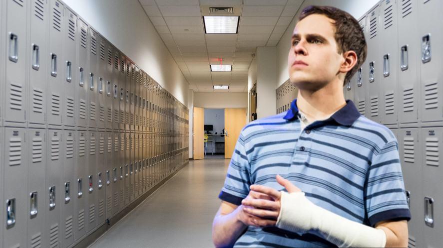 Evan Hansen in a long school corridor