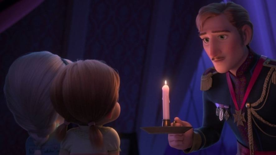 Anna and Elsa with their dad, who is holding a candle