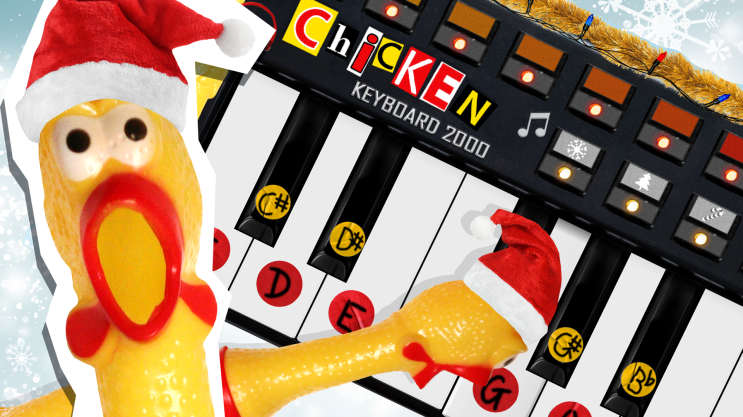 """Rubber chicken in a Christmas hat slamming their face on a keyboard labelled """"Chicken Keyboard 2000"""""""