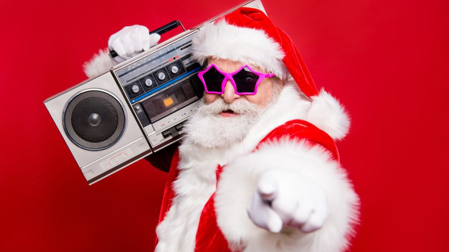Santa Claus in sunglasses holding a portable stereo