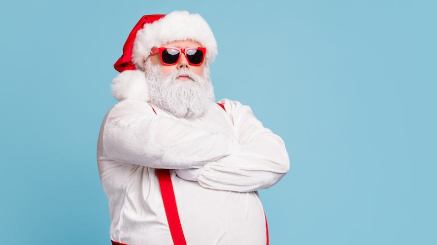 Santa Claus in red braces and sunglasses