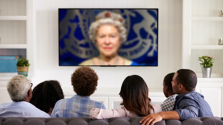 A family watching the Queen's speech on TV