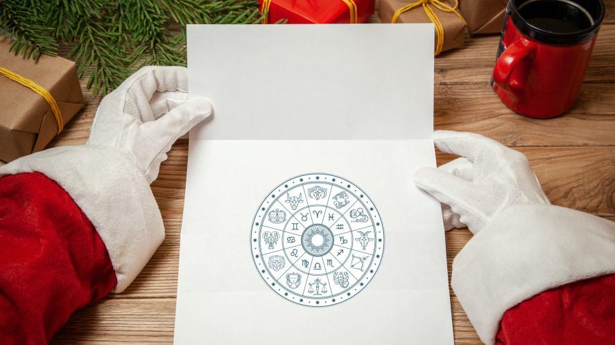 Santa looking at a Zodiac chart