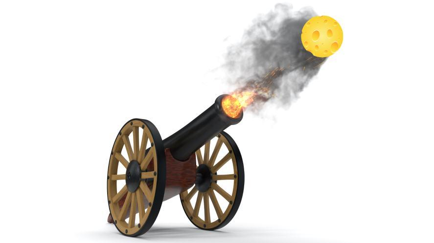 A cannon firing a ball of cheese