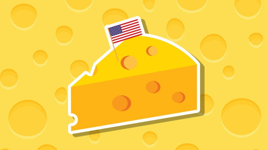 A wedge of cheese with the USA flag stuck on top