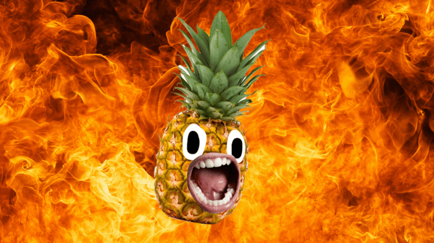 A pineapple in front of a fiery background