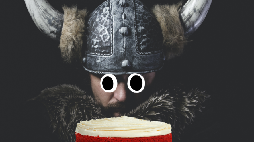 A viking about to eat a cake