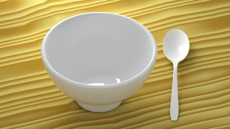An empty bowl and spoin