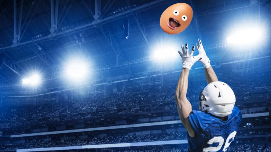 An American football player catching an egg
