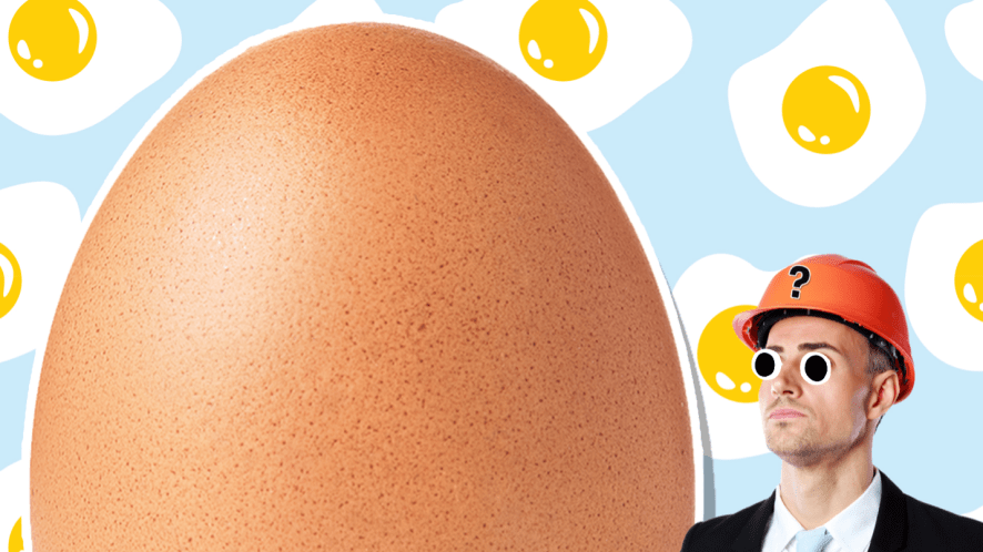 A man wearing a hard hat to protect himself from a big egg