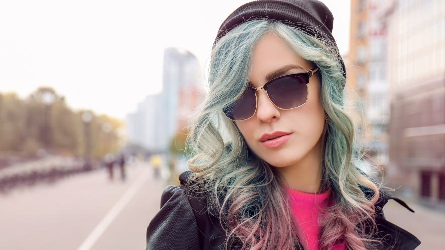 A woman in sunglasses and a beanie
