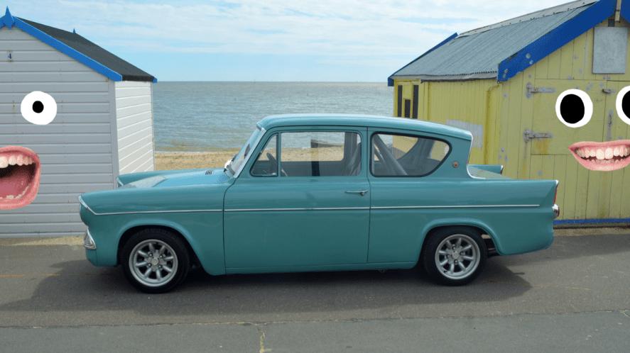A car parked at a British beach