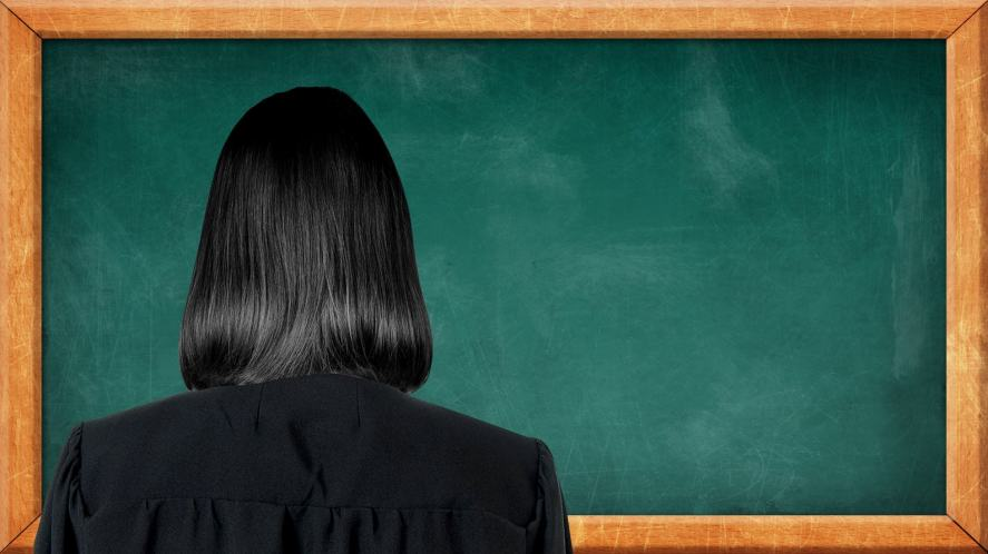 A mysterious teacher standing in front of a chalk board