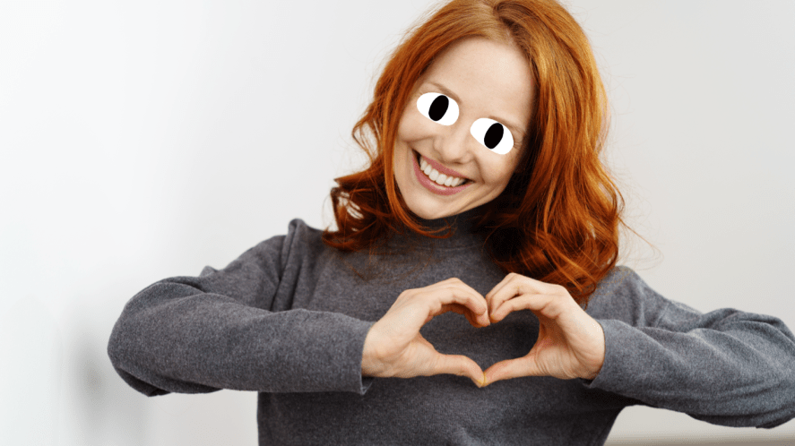 A woman making a heart shape with her hands