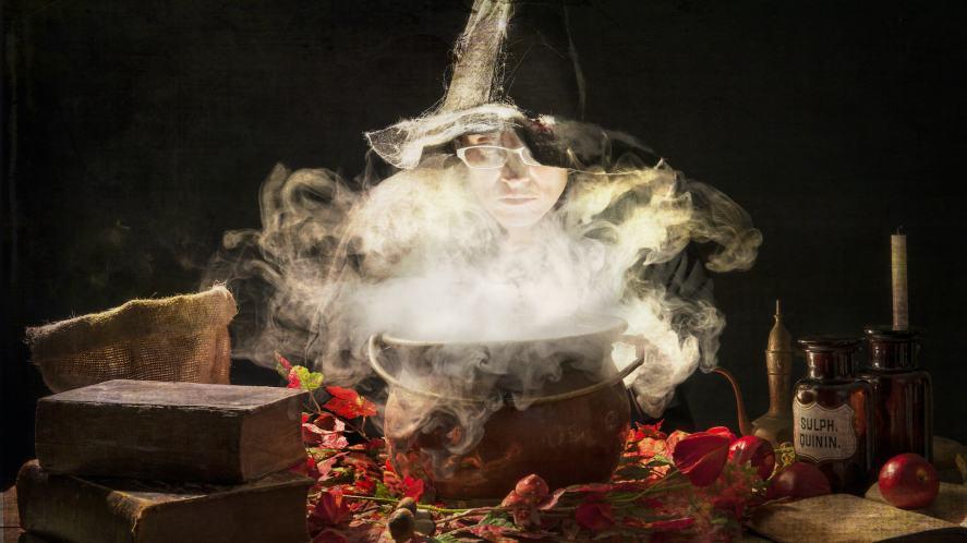 A wizard making a magic potion