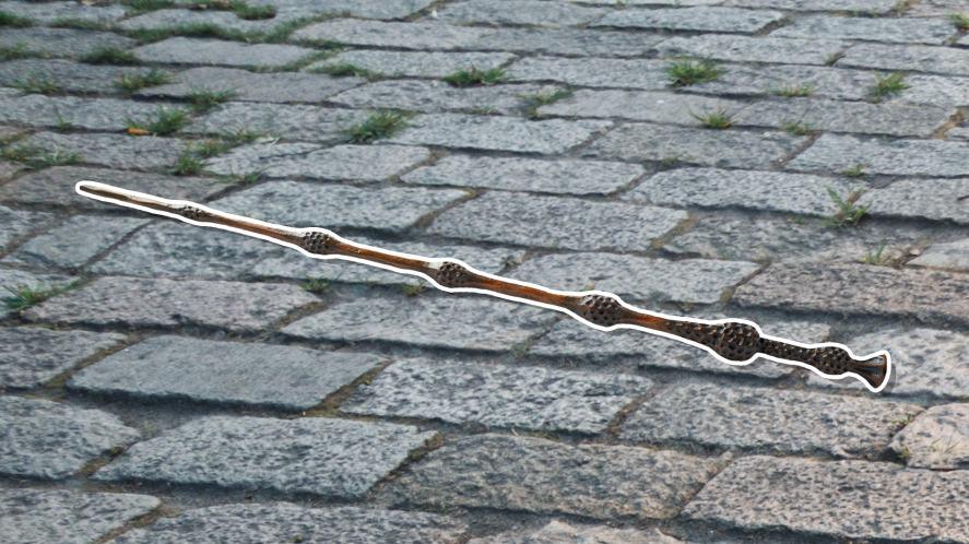 An Elder wand on a cobbled street