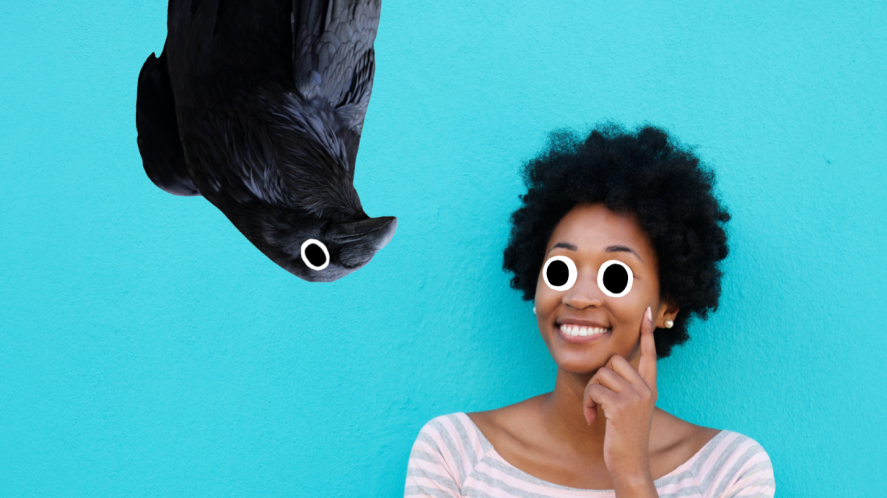 A woman thinking about this answer, while a bird stares from above