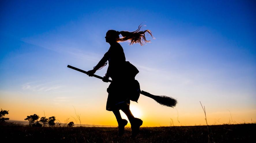 A girl flying on a broomstick