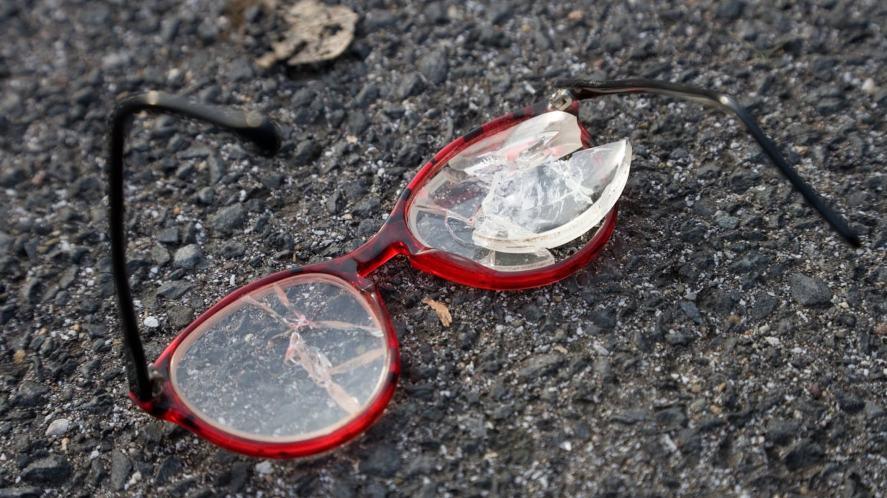 A broken pair of glasses