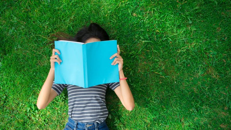 Someone reading on the grass