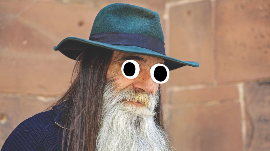 A man with a white beard and a hat
