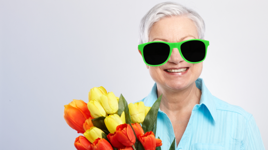 A grandma with a bunch of flowers