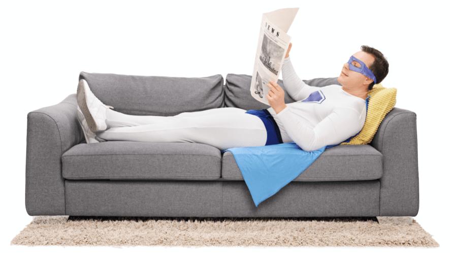 A superhero relaxing on a sofa