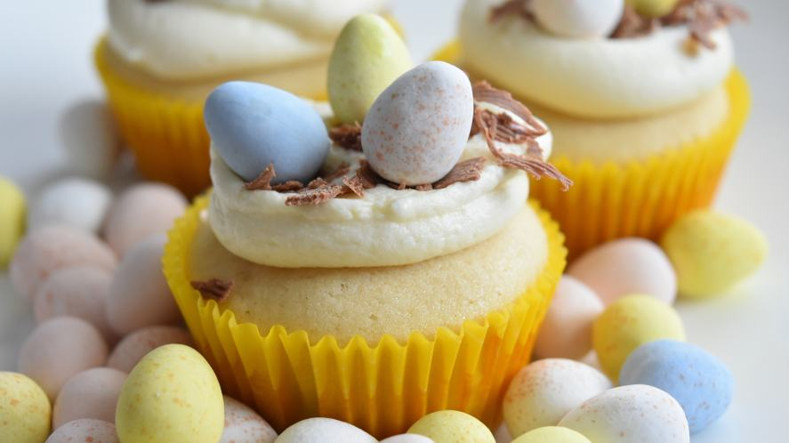 A cupcake decorated with small eggs
