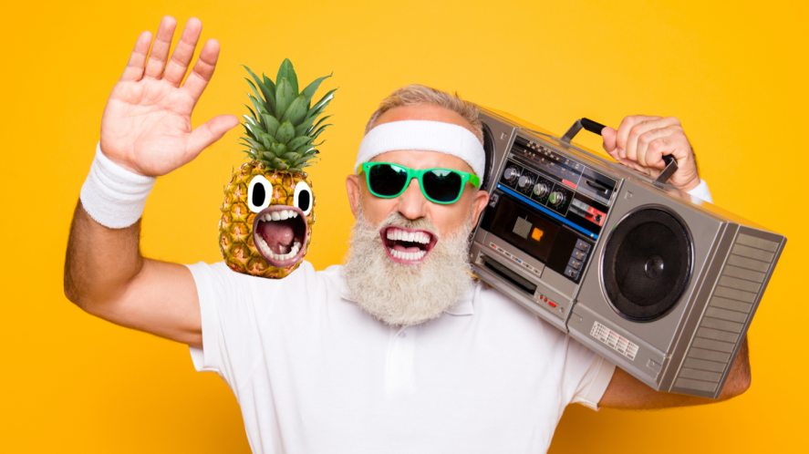 A man and a pineapple listening to music on a portable stereo