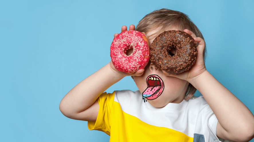 A child holding up donuts to his eyes
