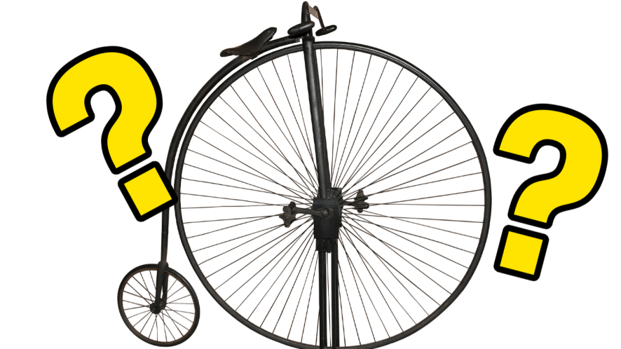 Penny farthing and question marks