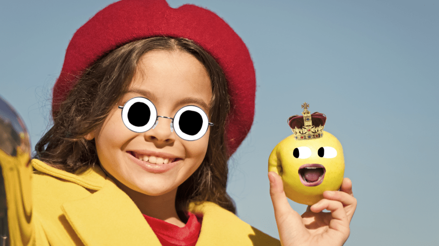 A girl about to eat an apple