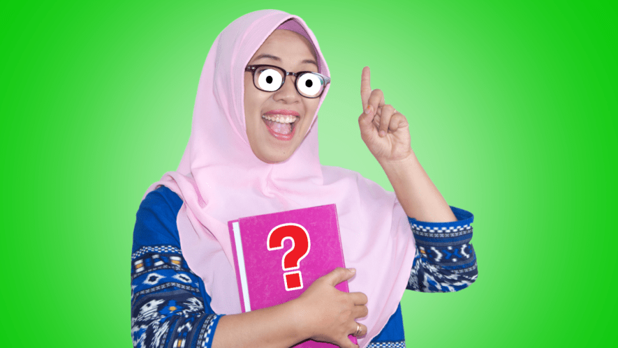 A woman in a Hijab holding a book