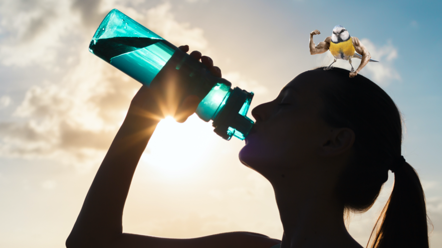 An athlete drinking from a bottle of water