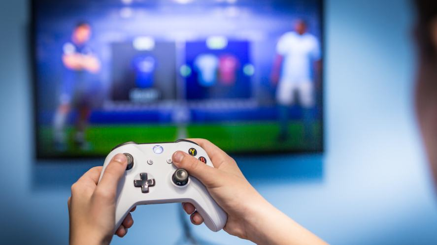A person playing an Xbox One game